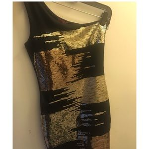 Black and gold sequin on should dress